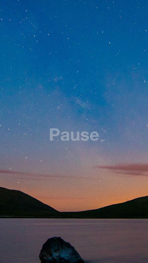 """Photo of dusk with the word """"Pause"""""""